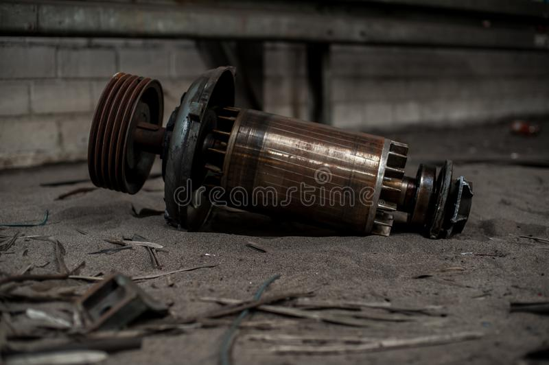 Huge core of electric motor in industrial ruins royalty free stock photo