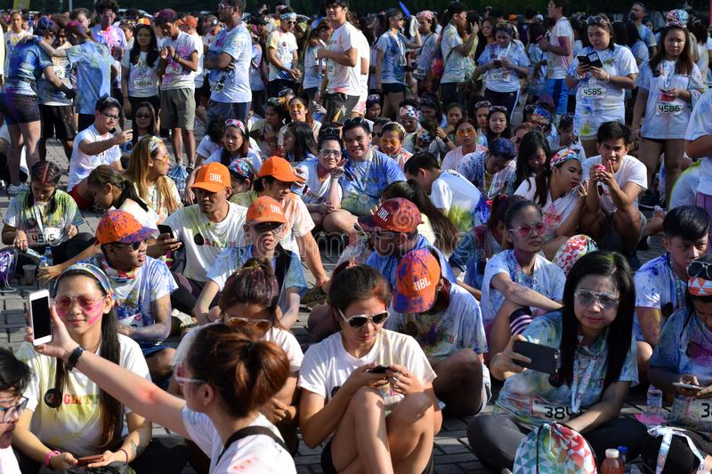 Huge crowd of Young people gather at Color Manila Glitter Run on city square. Public Event royalty free stock image