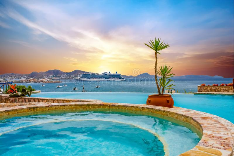 Huge Cruise Ship Anchored Beyond Tropical Pool royalty free stock images