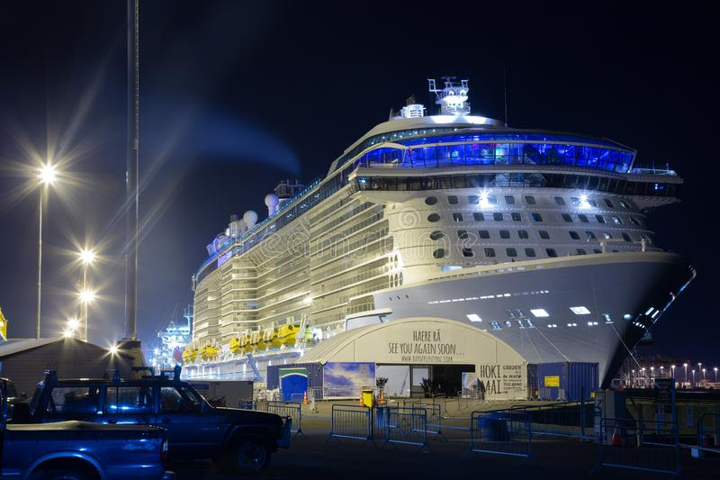 Huge cruise ship moored at night in Mount Maunganui, New Zealand. The Royal Caribbean liner `Ovation of the Seas` docked at the Port of Tauranga in Mount stock images