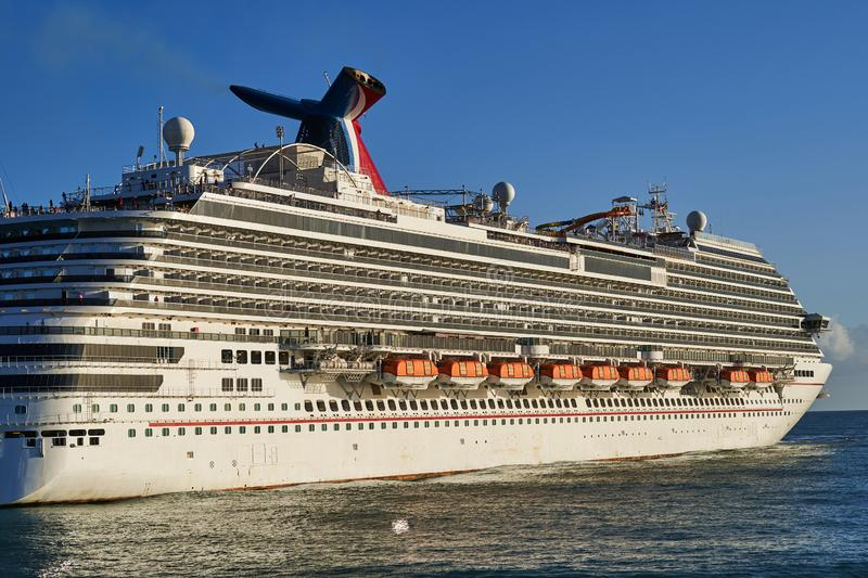 Huge cruise ship with passengers sailing in the ocean royalty free stock images
