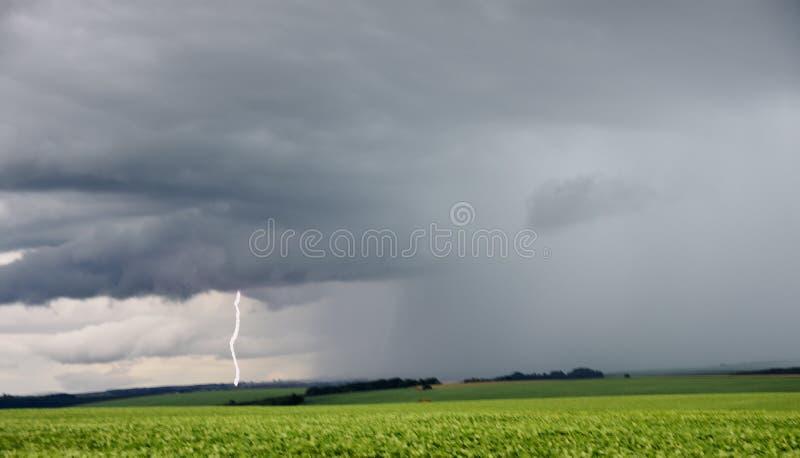Huge dark rain clouds on a nature field scene.  royalty free stock photos