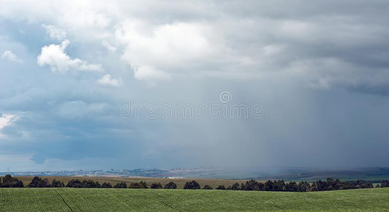 Huge dark rain clouds on a nature field scene.  royalty free stock images