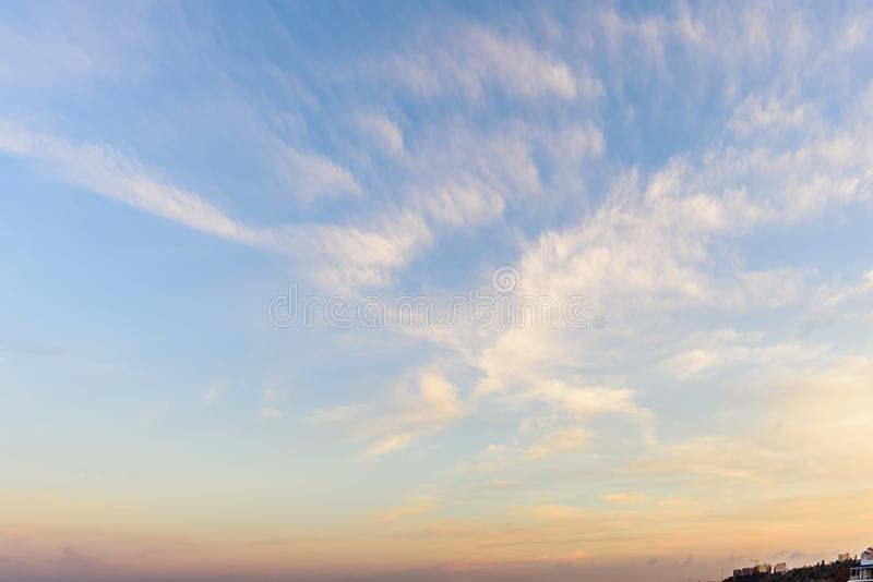 A huge, endless sky and clouds, illuminated by the rising sun. A huge, endless sky, illuminated by the rising sun, pink, blue, white fluffy clouds in summer time stock images