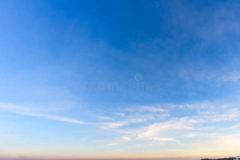 A huge, endless sky and clouds, illuminated by the rising sun. A huge, endless sky, illuminated by the rising sun, pink, blue, white fluffy clouds and a forest stock photos