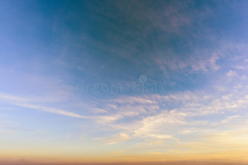 A huge, endless sky and clouds, illuminated by the rising sun. A huge, endless sky, illuminated by the rising sun, pink, blue, white fluffy clouds in summer time royalty free stock image