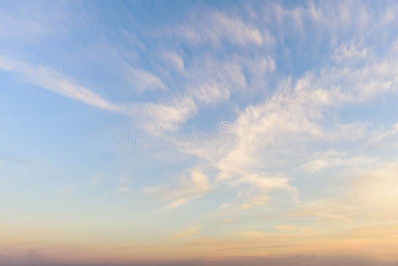 A huge, endless sky, illuminated by the rising sun. Pink, blue, white fluffy clouds in summer time royalty free stock photo