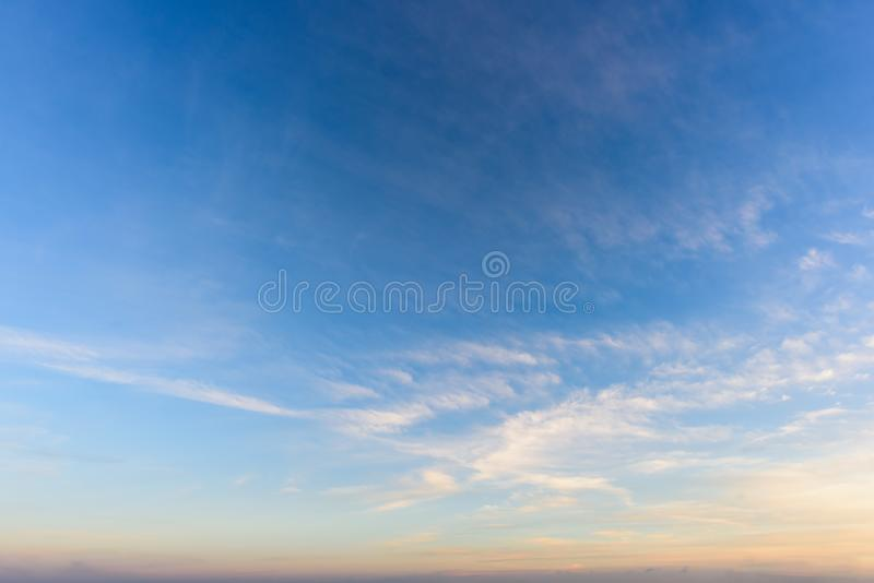A huge, endless sky, illuminated by the rising sun. Pink, blue, white fluffy clouds in summer time royalty free stock photos
