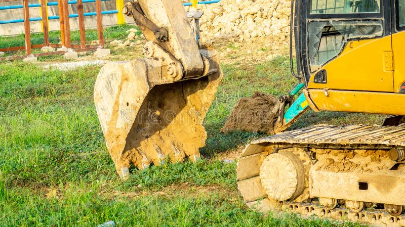 Huge excavator park on construction work site royalty free stock image
