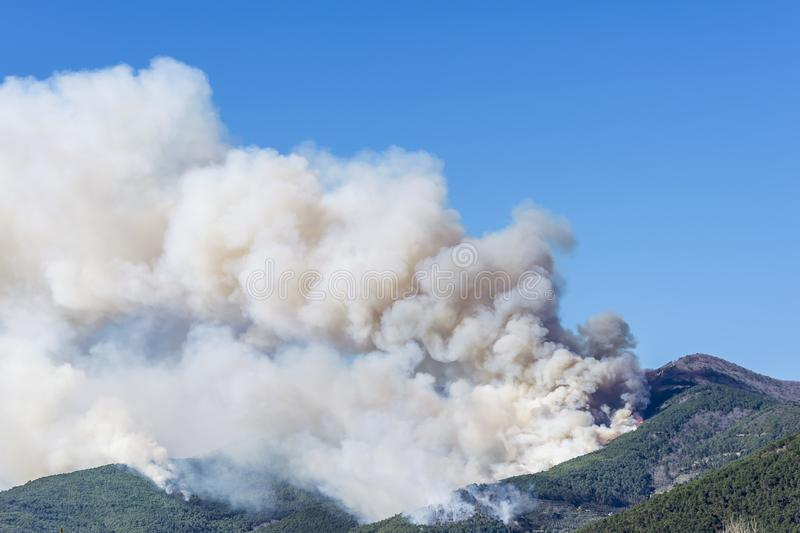 Huge fire in the woods of Monte Pisano threatens the inhabited centers of Vicopisano and Bientina, Tuscany, Italy royalty free stock photography