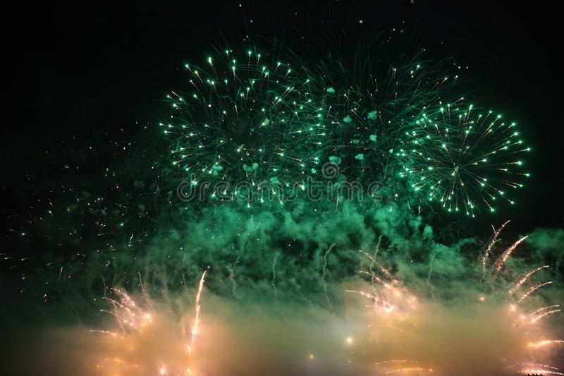 Huge fireworks in the sky with green sparks royalty free stock image