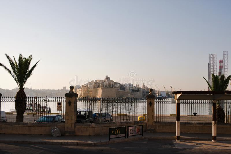 Floriana, Malta, August 2019. View of the fortifications on the other side of the bay. A huge fortress on the other side of the bay is perfectly visible through royalty free stock image