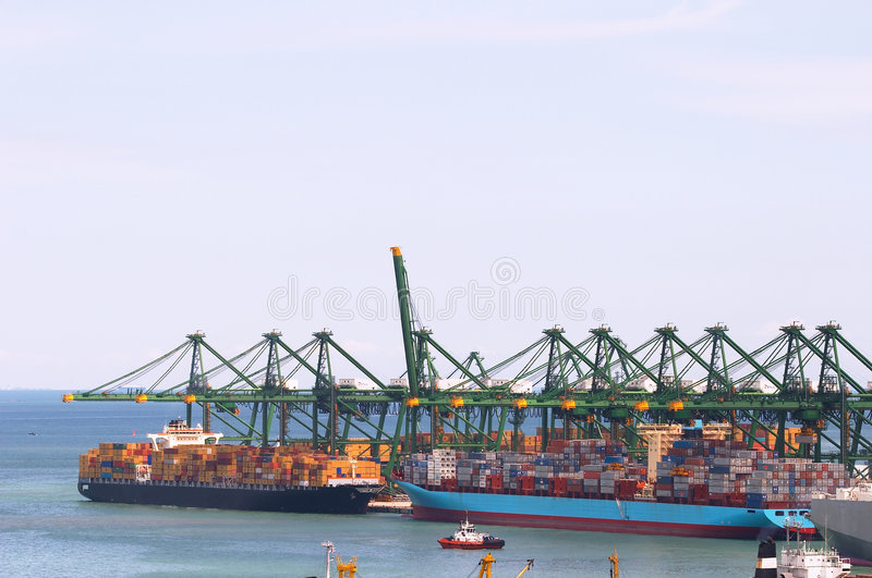 Huge gantry cranes and cargo container ships royalty free stock photo