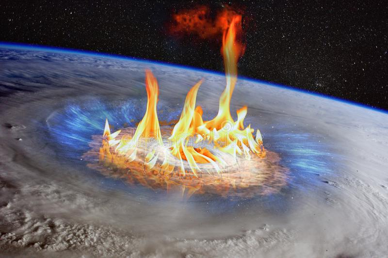 Huge gas stove burner armageddon conceptual image. Huge gas stove burner between hurricane in a planet Earth, satellite view, armageddon conceptual image royalty free stock photos
