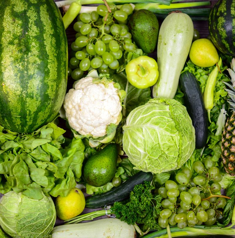 Huge group of fresh green fruit and vegetables - Concept of healthy green food stock image