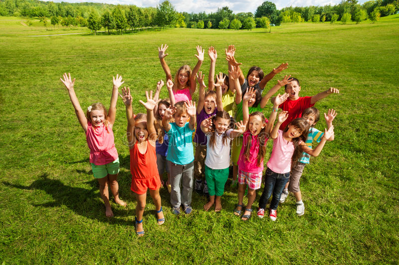Huge group of kids in the park royalty free stock photography