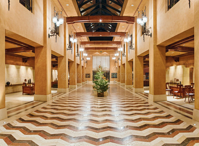 Huge hall interior in golden colors royalty free stock photography