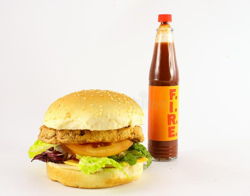 Huge hamburger with hot sauce stock image