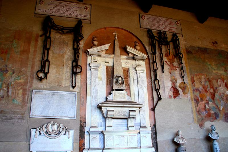 PISA, ITALY - CIRCA FEBRUARY 2018: Chains of the medieval harbour of Pisa in the Monumental Cemetery at the Square of Miracles royalty free stock photography