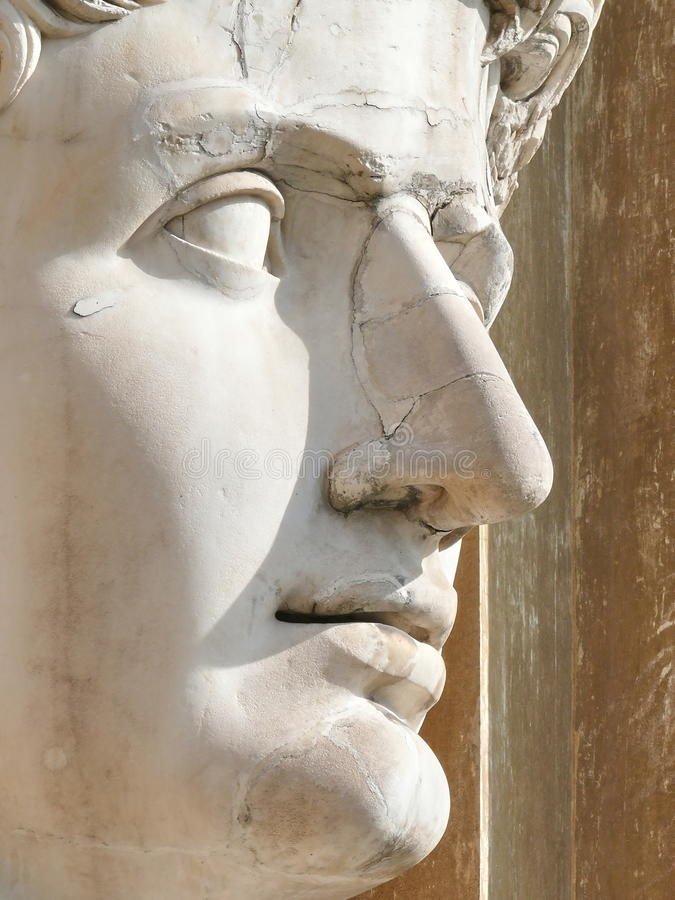 Huge head carved in marble. Vatican. Rome. Italy stock photos