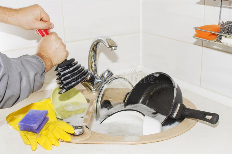 Huge heap of dirty dishes waiting for the flatmate royalty free stock photo