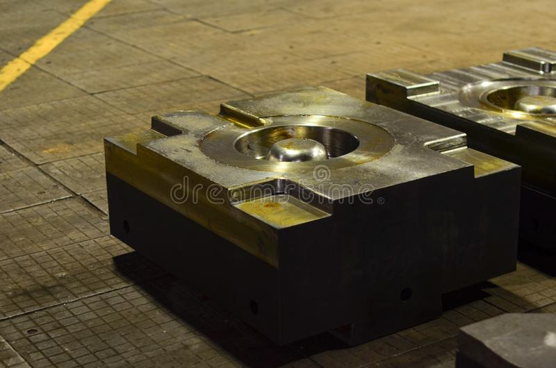 High precision die mold for casting automotive aluminium parts make with iron metal steel. A huge heavy iron product. Forged stamping. Stamp for metal casting stock photos