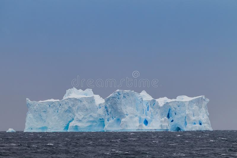 Huge iceberg off coast of Antarctica called The Wedding Cake stock photos