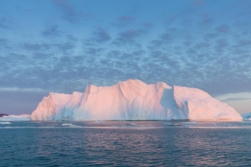 Huge icebergs of different forms in the Disko Bay, West Greenland. Their source is by the Jakobshavn glacier. Greenland. Huge icebergs of different forms in the royalty free stock images