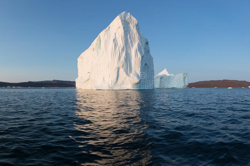 Huge icebergs of different forms in the Disko Bay, West Greenland. Their source is by the Jakobshavn glacier. Greenland. Huge icebergs of different forms in the royalty free stock image