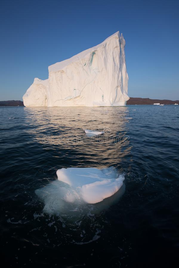Huge icebergs of different forms in the Disko Bay, West Greenland. Their source is by the Jakobshavn glacier. Greenland. Huge icebergs of different forms in the royalty free stock photography