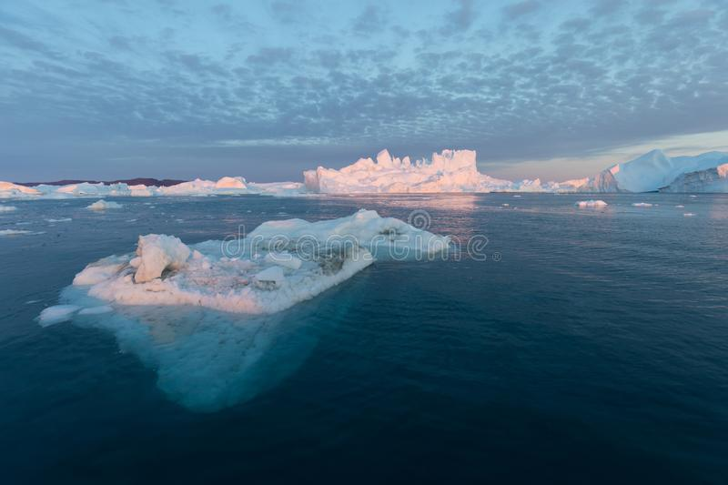 Huge icebergs of different forms in the Disko Bay, West Greenland. Their source is by the Jakobshavn glacier. Greenland. Huge icebergs of different forms in the stock photography