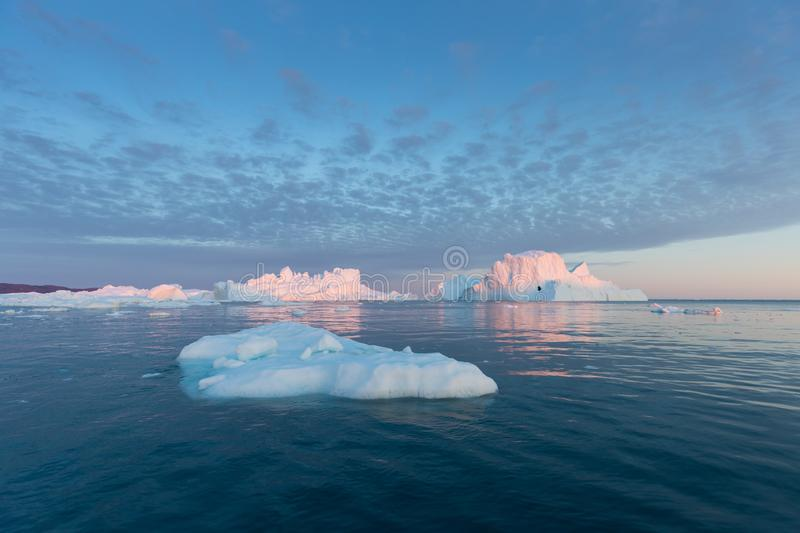 Huge icebergs of different forms in the Disko Bay, West Greenland. Their source is by the Jakobshavn glacier. Greenland. Huge icebergs of different forms in the stock images