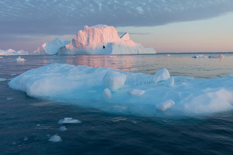 Huge icebergs of different forms in the Disko Bay, West Greenland. Their source is by the Jakobshavn glacier. Greenland. Huge icebergs of different forms in the stock image