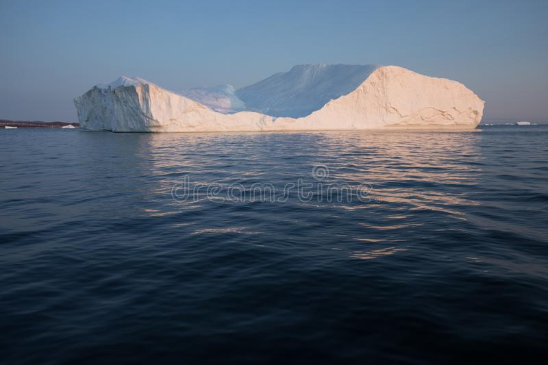 Huge icebergs of different forms in the Disko Bay, West Greenland. Their source is by the Jakobshavn glacier. Greenland. Huge icebergs of different forms in the royalty free stock photos