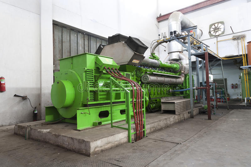 Huge industrial standby dieasel generator. Huge industrial standby dieasel generator at a power generation plant in a textile factory stock photos