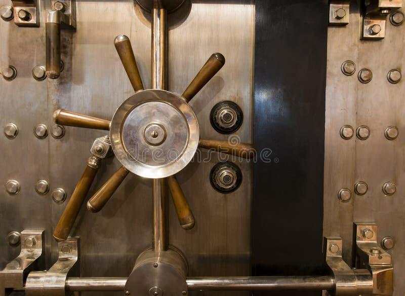 Huge Inpenetrable Vintage Bank Vault Massive Handle. Locked bank vault door in retail store royalty free stock image