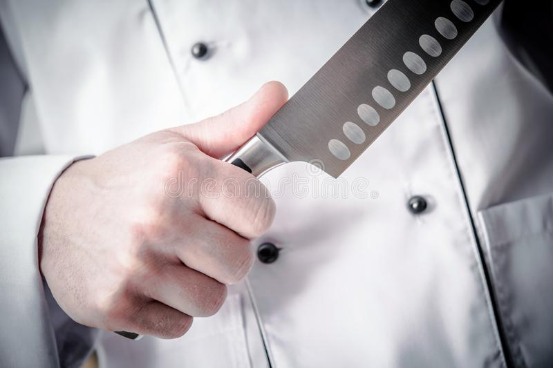 Huge Knife and Cooking Time royalty free stock photography