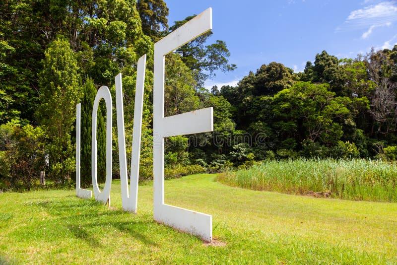 Huge LOVE sign sculpture in a garden. Huge LOVE sign sculpture in a garden in Australia royalty free stock photos