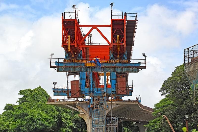 Erection of Deck for Elevated Road. Huge machinery for placing precast concrete segments over columns for the deck of elevated road, part of third bridge across royalty free stock images