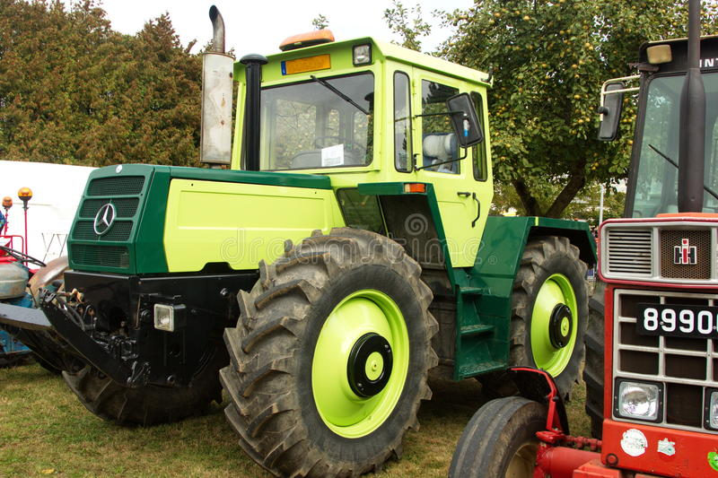 Huge Mercedes green tractor royalty free stock image