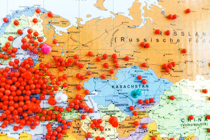 Red pins in Europe and other continents on a world map with shallow DoF. Huge number of red pins in Europe and other continents on a world map with shallow DoF royalty free stock photo