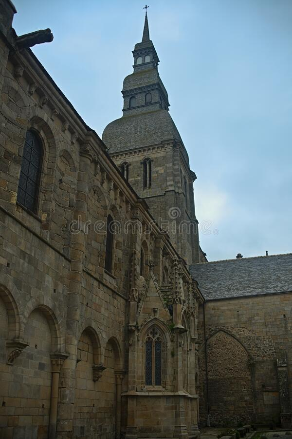 Huge old medieval stone catholic church in Dinan, France.  stock photography