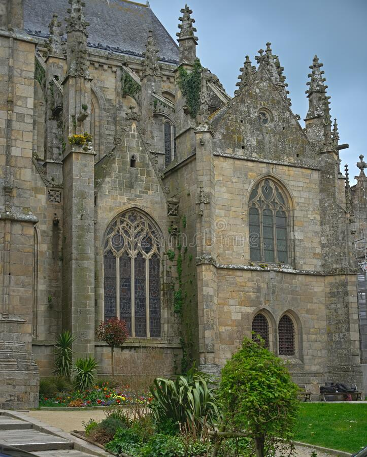 Huge old medieval stone catholic church in Dinan, France.  royalty free stock photo