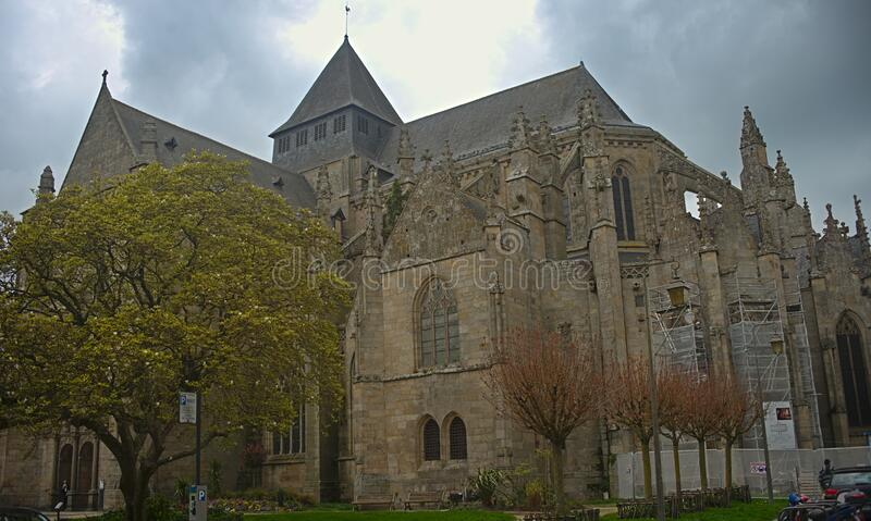 Huge old medieval stone catholic church in Dinan, France.  royalty free stock photos