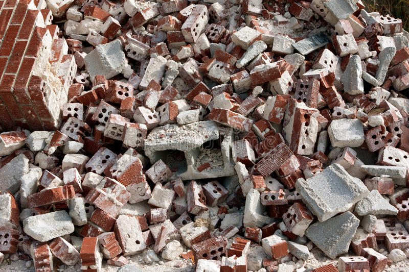 Huge Pile Of Discarded Broken Bricks At Demolition Site royalty free stock photography