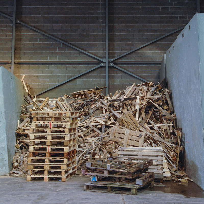 Huge pile of wood waste for recycling stock image