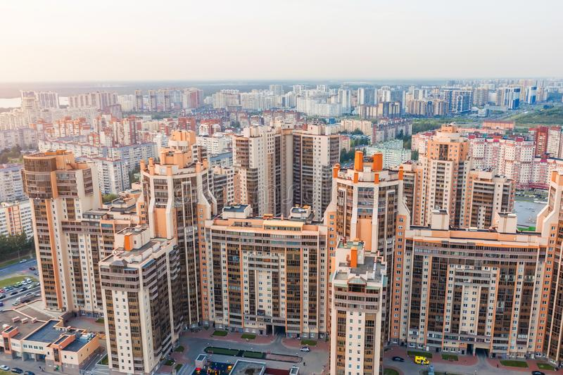 Huge residential area multi-storey high-rise buildings to the horizon, the evening sky aerial view.  royalty free stock photography