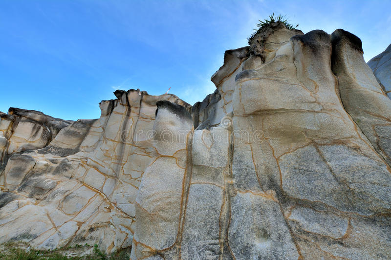 Huge rock as decayed granite with featured pattern. Weathering and decayed granite under blue sky in Fujian, South of China, as featured geology landforms, with stock photo