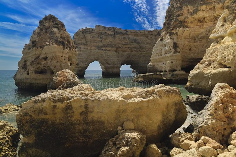 Huge rock at the cliff beach of Praia da Marinha, lovely hidden beach near Lagoa Algarve Portugal stock image