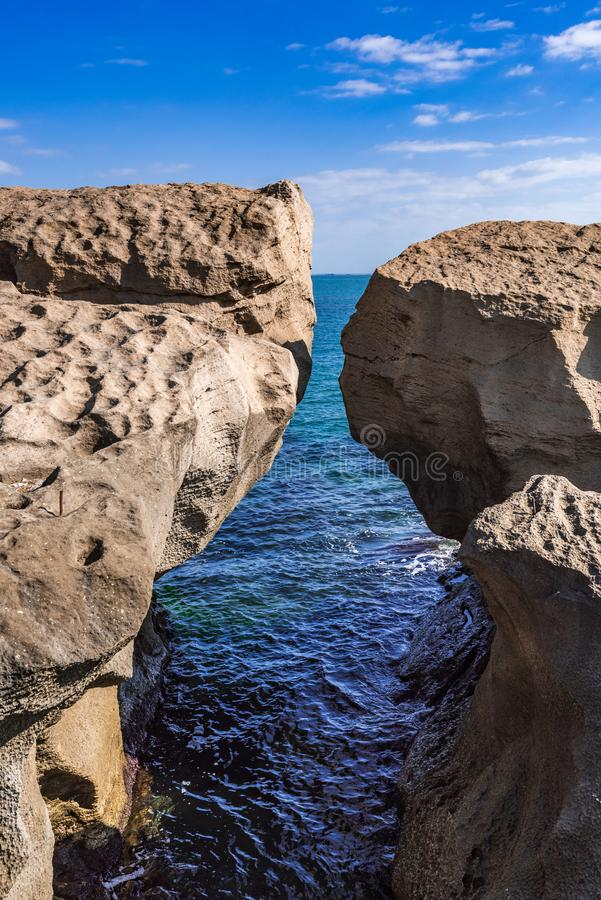 Huge rock on the shore in the form of an arch. A huge rock on the shore in the form of an arch royalty free stock photo